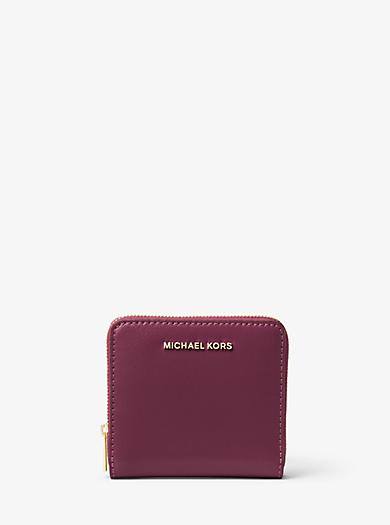 Porta carte di credito Jet Set Travel in pelle Saffiano metallizzata by Michael Kors
