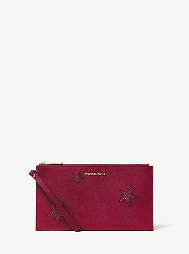 Jet Set Travel Large Star Leather Clutch by Michael Kors