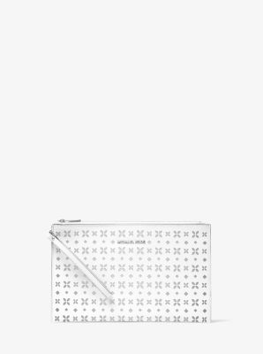 Jet Set Travel Extra-Large Perforated-Leather Clutch by Michael Kors