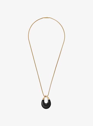 Collana tonalità oro con pendente nero by Michael Kors
