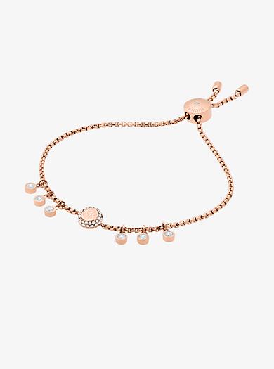 Braccialetto con cursore tonalità oro rosa con cristalli e logo by Michael Kors