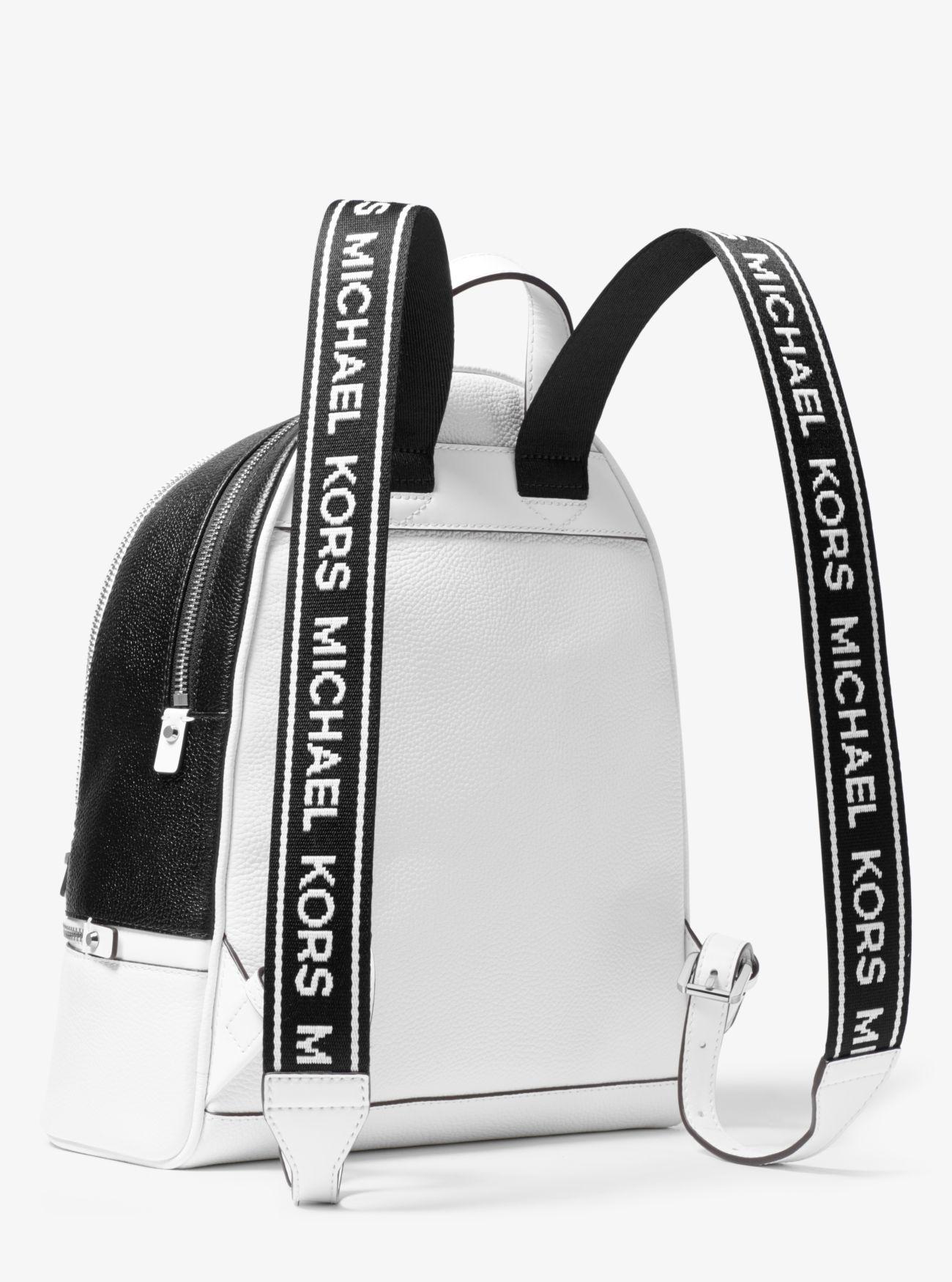 162bd5942bb5 ... Rhea Medium Logo Tape Backpack Rhea Medium Logo Tape Backpack. MICHAEL  Michael Kors
