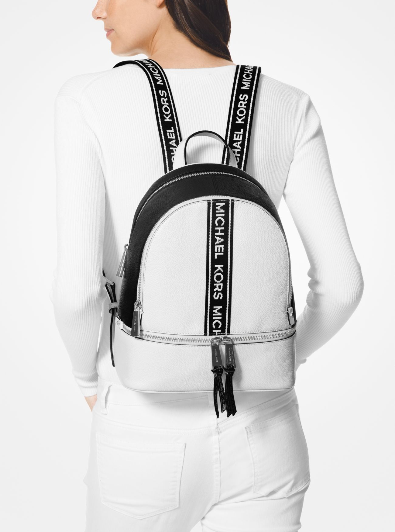 98b813c6f663 ... Rhea Medium Logo Tape Backpack. MICHAEL Michael Kors