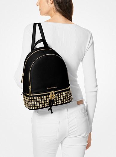 dac5ad88ab70 Rhea Medium Studded Pebbled Leather Backpack. MICHAEL Michael Kors