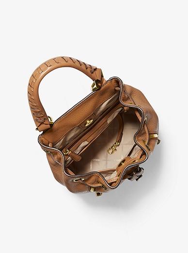 b12c35c01ad262 Viv Medium Pebbled Leather Bucket Backpack | Michael Kors