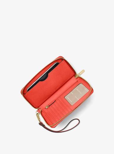 8ee11e96b440 Large Leather Smartphone Wristlet. Large Leather Smartphone Wristlet. MICHAEL  Michael Kors