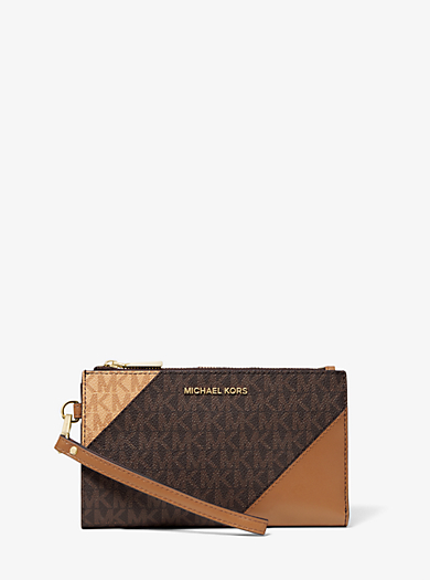 b91bcc77f029 Adele Two-Tone Logo and Leather Smartphone Wallet. michael michael kors ...