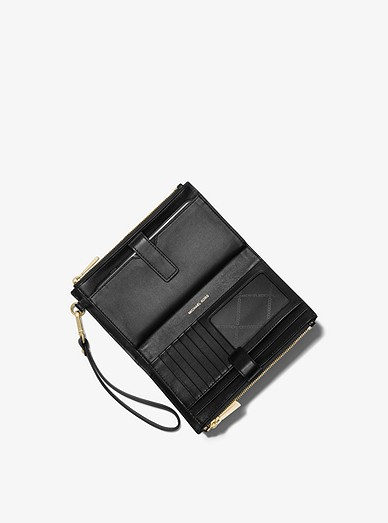 aed3f1dfb6a2 Adele Logo Smartphone Wallet. Adele Logo Smartphone Wallet. MICHAEL Michael  Kors