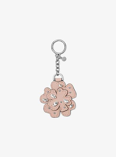 d834469046 Portachiavi con fiore in pelle e cristalli. michael michael kors ...