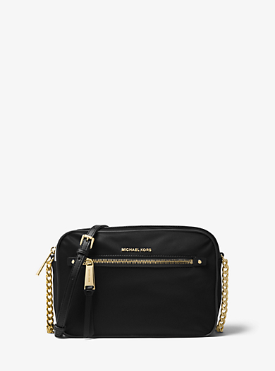 6263b73c5af Polly Large Nylon Crossbody. Find a Store. Sign Up for updates from Michael  Kors