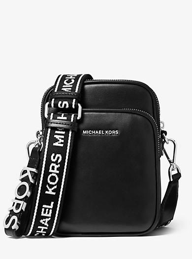 c9309004a13749 Borsa a tracolla media in pelle con fettuccia con logo. michael michael kors  ...