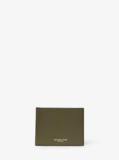 d9e66205c7 ... Porta carte di credito Jet Set grande con stampa tropicale · 69,00  €69,00 € · Portafoglio a libro Odin sottile in pelle