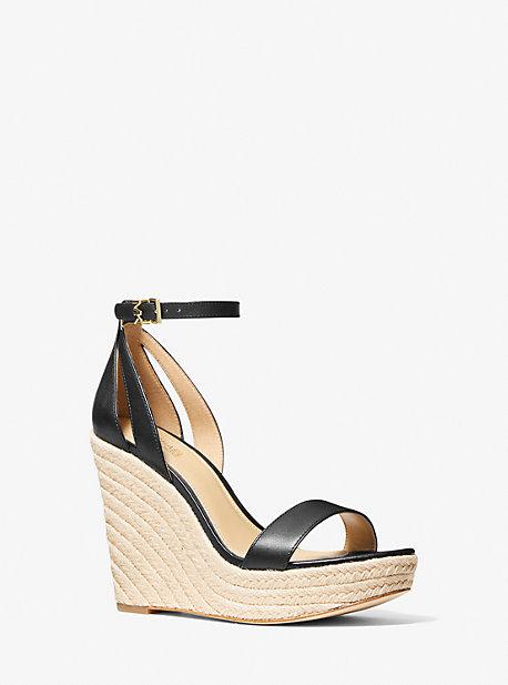 마이클 마이클 코어스 킴벌리 웻지 샌들 Michael Michael Kors Kimberly Leather Wedge Sandal,BLACK