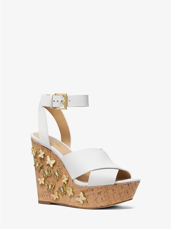 5debfc31414 Lacey Butterfly Embellished Leather Wedge