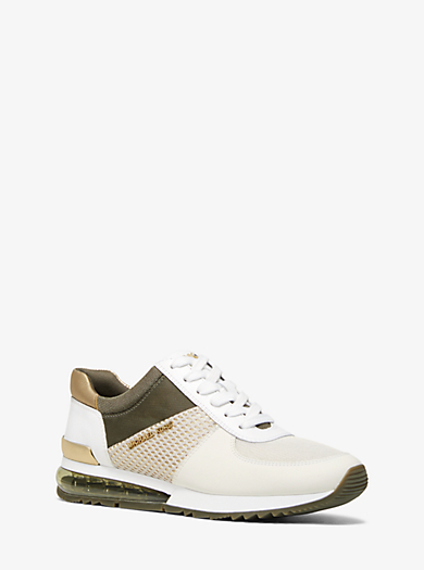 f13b75f8896e4 Allie Extreme Mixed-Media Trainer. michael michael kors ...
