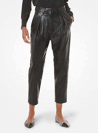 Pantalone in similpelle con pieghe