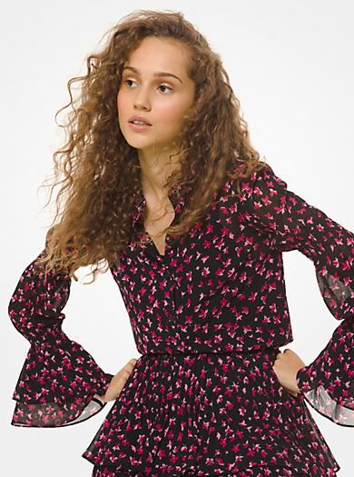 Blusa in georgette con polsini a campana e motivo floreale
