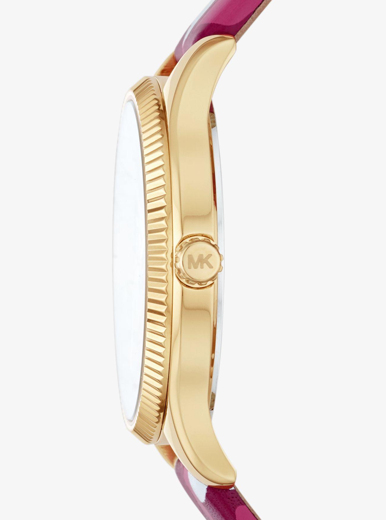 ... Orologio Lexington mini tonalità oro con farfalle camouflage e cinturino  in pelle 059461cc350