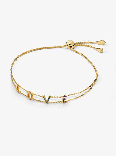 85fd8b856a36 Pulsera Love de plata de ley chapada en oro de 14 K con incrustaciones tipo  arcoíris. michael kors ...