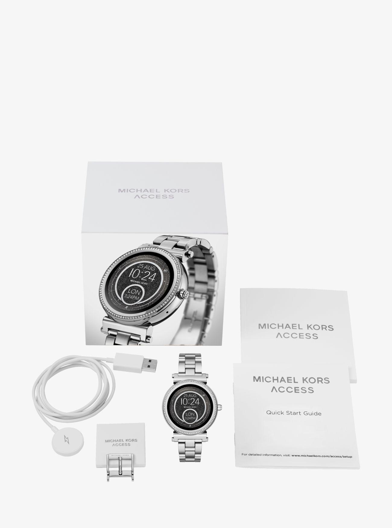 c258dd10db75 ... incrustaciones Reloj inteligente Sofie en tono plateado con  incrustaciones. Michael Kors Access