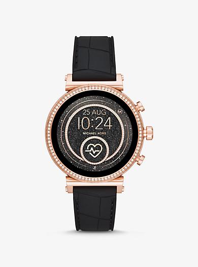 77bc8633c315 Reloj inteligente Sofie Heart Rate en tono dorado rosa de silicona en  relieve. michael kors ...